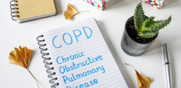 COPD Chronic Obstructive Pulmonary Disease written in notebook on white table